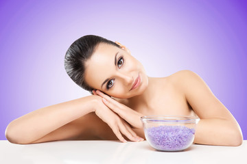 Portrait of young, beautiful and healthy woman with a mineral sa