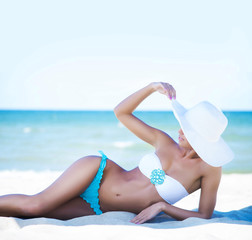 Gorgeous and beautiful young girl relaxing on a summer beach