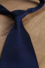Elegant blue tie on a wooden background