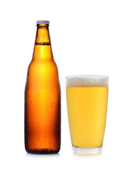 A bottle and glass of beer isolated on white