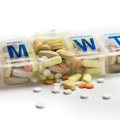 Pills spill out of a dossette box