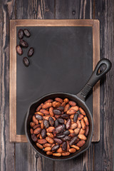 cocoa beans in pan and chalk board