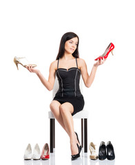 Young and attractive woman choosing shoes