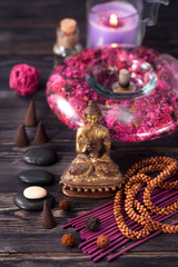 Buddha statue, zen stones and incense. concept of meditation