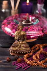 Statue of Buddha, incense and aromatic oils, meditation