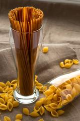 Art still life shell macaroni pasta in glass on hessian linen