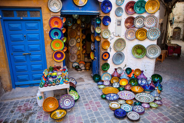 brightly colored ceramics exposed front of the store, Morocco