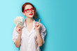 canvas print picture - women in red glasses with money