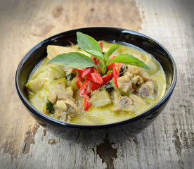 Green curry Chicken Intense soup on wood, Thai cuisine