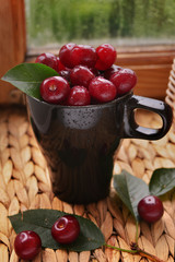 cherry black Cup on wooden table