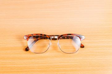 eyeglasses isolated on wooden background