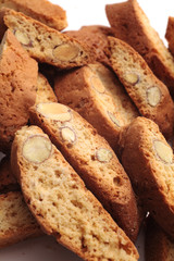 Cantuccini alla mandorla, italian cookies, on white background