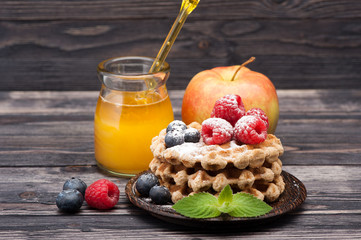 Waffles with berries, fruit and honey