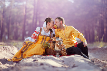 couple on nature in national dress