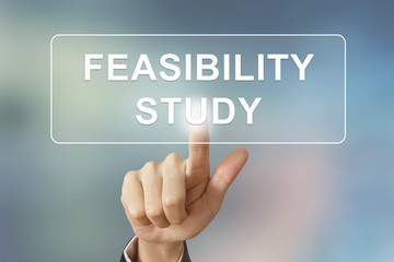 business hand clicking feasibility study button on blurred backg
