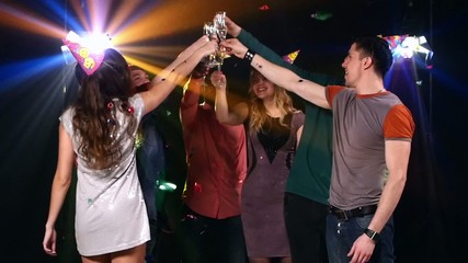 Nightclub : friends  party and dancing clink glasses. Slow