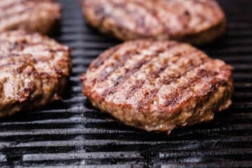 Preparing a batch of  grilled ground beef patties or frikadeller