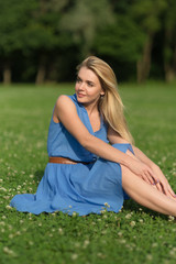 Girl in blue dress enjoying summer day