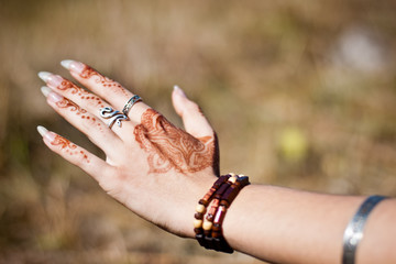 Hand with henna patterns and rings