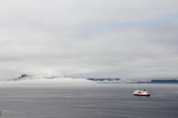 Ship in Foggy fjord