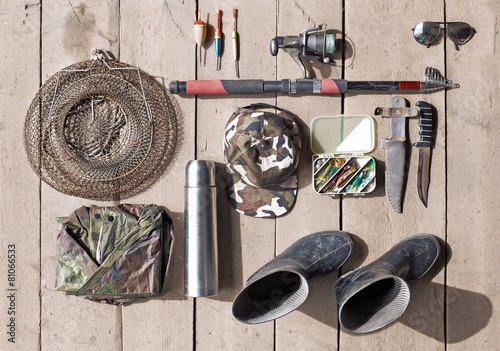 Staande foto Vissen Overhead of essentials for fisherman. Fshing tackle and equipmen
