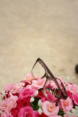 Glasses on beautiful flowers at the park