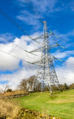 Electricity Pylon on a Field and Blue Sky