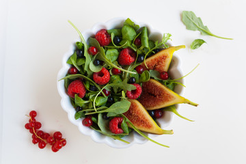 Salad with fresh vegetables and fruit, elegant and minimalist co