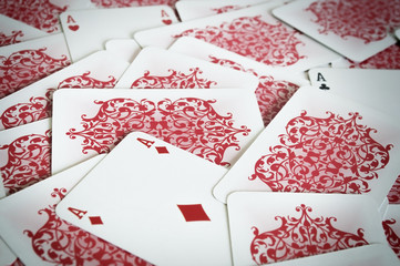 Pile of playing cards with turned aces