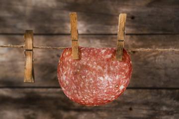 Slices of salami hanging