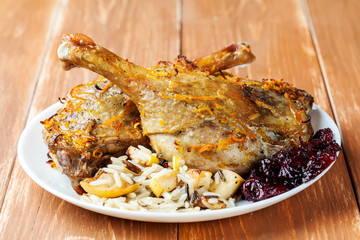 Roasted duck legs with cherry sauce and rice