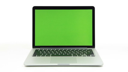 Hands typing laptop with green screen on white background