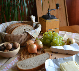 Cheese, bread, onions, wine and grinder