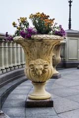 patterned stone floor vase park