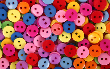 Colorful buttons pile multicolor background