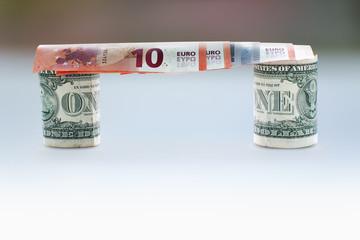 Bridge of euro banknotes and dollars