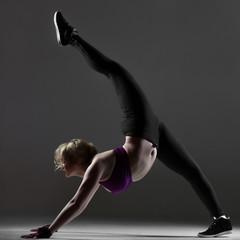 Beautiful sporty girl doing fitness exercises