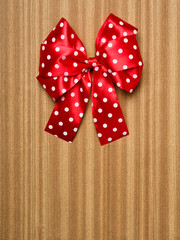 red bow on wood background