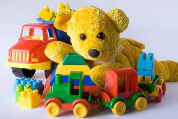 Teddy bear and plastic toys