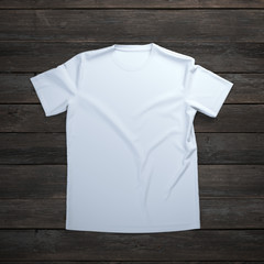 White t-shirt on wooden background