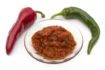 Chutney of peppers with spices isolated on white