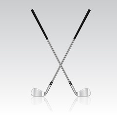 Two crossed golf clubs with reflection