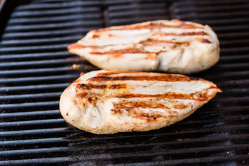 Grilled chicken breast fillets on BBQ