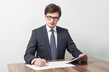 Young businessman is checking contracts