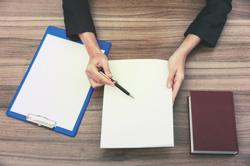 businesswoman's hands while checking some documents