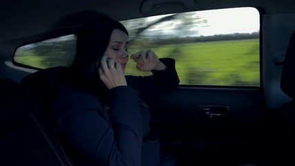 Woman on the phone in car almost crying sad