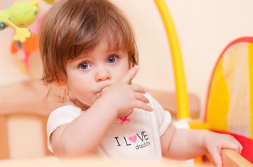 little girl standing in the crib