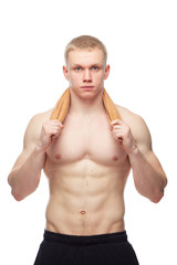 Happy muscular guy with towel over white background