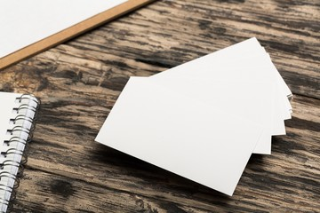 Mockup. Blank white business cards on wood background