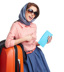 Elegant woman with a suitcase travel